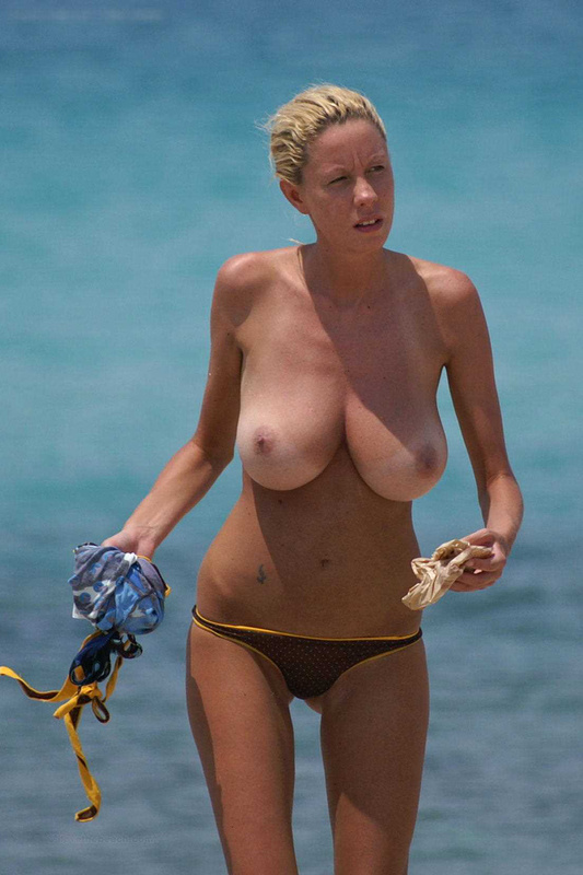 Topless Blonde Woman with Big Tits at the Beach