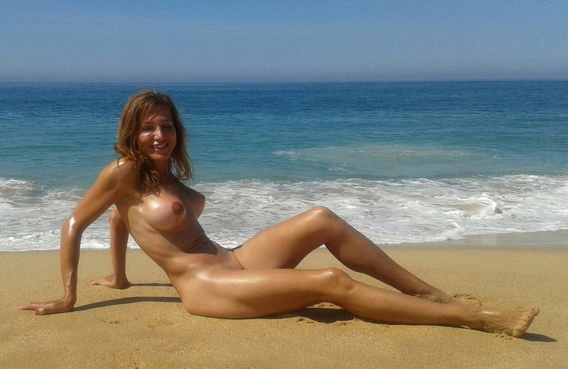 Picture nude wife with big fake boobs at the beach