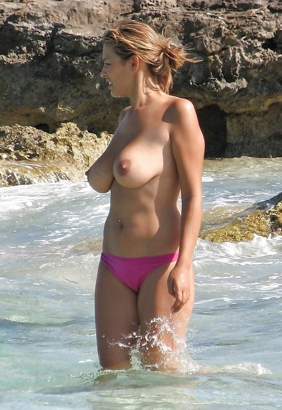 Picture nude woman with nice big boobs at the beach