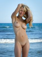 Beautiful Blonde Nudist Girl at the Beach