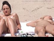 Two nudist women filmed voyeur at the beach