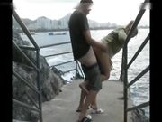 Couple makes outdoor sex by the sea